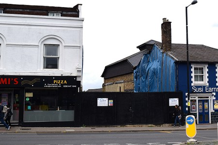 pizza shop and a gap with black hoarding and the Bull Theatre