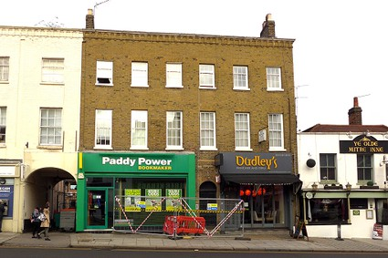 Paddy Power and Dudley's with flats above with glazing bars added to windows