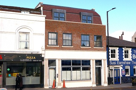 Three storey building with shop unit not in use