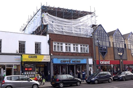 shop with scaffolding over the roof