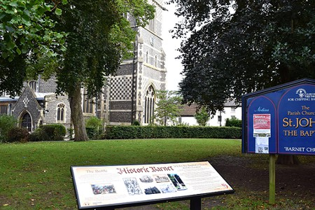 Historic Barnet information board with part of St Johns church in the background